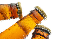 Bottles of beer. Close of ther top of three bottlers of beer Stock Photo