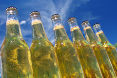 Bottles of beer. With the sky as background Stock Image