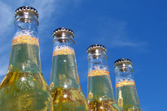 Bottles of beer. With sky background Stock Photos