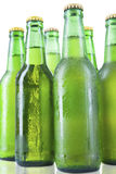 Bottles of beer with drops isolated Royalty Free Stock Photo