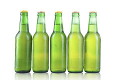 Bottles of beer with drops isolated Stock Photo
