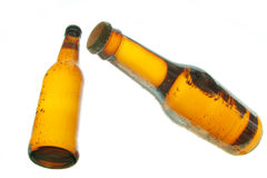 Bottles of beer floating royalty free stock photography