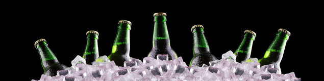 Bottles of beer on ice Stock Photo