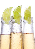 Bottles of beer with lime Royalty Free Stock Images