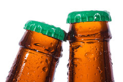 Bottles of beer with water drops Royalty Free Stock Images