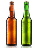Bottles of beer with water drops on white Stock Images