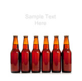 Bottles of beer on white with copy space Stock Photos