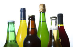 Bottles of beer and wine. Different coloured beer and wine bottles stock image