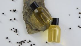 Bottles with black peper essential oil. Natural cosmetic treatment products. Bottles with black peper essential oil. Natural healthy cosmetic treatment products stock video