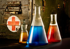 Bottles with blue red brown liquid. Multicoloured fluid in glass bottles Stock Photos