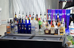 Bottles of Booze, Liquor, Alcohol in a Bar, Tavern. Different brands of booze, liquor, or alcohol in a bar or tavern. Multiple bottles of adult beverages can be Stock Image