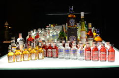 Bottles of Booze, Liquor, Alcohol in a Bar, Tavern. Different brands of booze, liquor, or alcohol in a bar or tavern. Multiple bottles of adult beverages can be Stock Photography