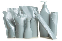 Bottles bottles and containers gray colored box with a white background Stock Images