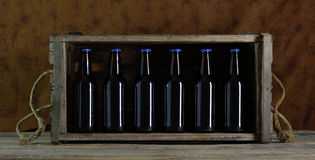 Bottles in a box Royalty Free Stock Images