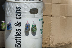 Bottles & cans recycling barrel Stock Photos