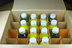 Bottles in a cardboard box Royalty Free Stock Photos
