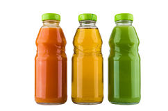 Bottles with carrot, kiwi and apple juice Stock Photography
