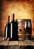 Bottles and cask of wine Royalty Free Stock Photography