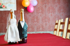 Bottles of champagne wearing like a newlywed Stock Photo