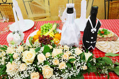 Bottles of champagne wine dressed in wedding gowns Royalty Free Stock Photo