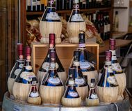 Bottles of Chianti in San Gimignano. Bottles of Chianti on display in a small shop, in San Gimignano, a small Italian town in Tuscany, Italy royalty free stock photo