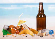 Bottles, cigarette butts and other debris in the sand on theseashore. Stock Images