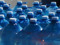 Bottles with clean drinking water large stock images