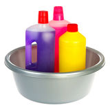 Bottles cleaning liquids. Plastic bottles cleaning liquids in gray bucket isolated over white Stock Images