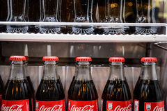 Bottles of coca-cola famous drink in the fridge. Serbia - March 9, 2016: Glass bottles of famous coca-cola drink in the fridge. Picture was taken in Alloro, one Stock Photos