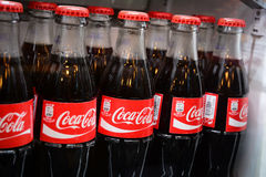 Bottles of coca-cola famous drink in the fridge. Serbia - March 9, 2016: Glass bottles of famous coca-cola drink in the fridge. Picture was taken in Alloro, one Royalty Free Stock Images