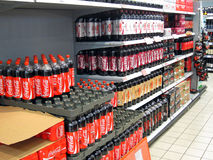 Bottles of coca cola on a store shelf. Royalty Free Stock Photo