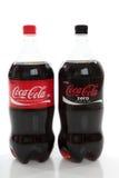 bottles cocaen - colasodavatten Arkivbilder