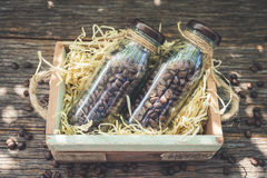 Bottles of Coffee beans in wood box with selective focus point.  Stock Images