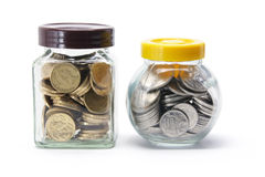 Bottles of Coins Stock Photography