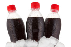 Bottles of cola in ice Stock Photos
