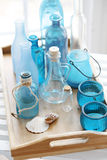 Bottles. Collection of vintage bottles on a wooden tray Royalty Free Stock Photography