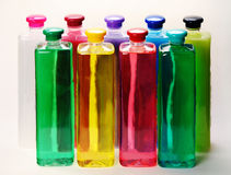 Bottles with color liquids. Stock Photography