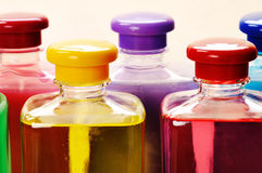 Bottles with color liquids. Stock Image