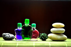 Bottles with colored aroma oils. Compositions Royalty Free Stock Images