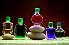 Bottles with colored aroma oils. Compositions Royalty Free Stock Photo