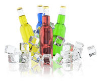 Bottles with colored drinks and ice cubes Royalty Free Stock Photos