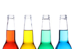 Bottles colored isolated Stock Photography