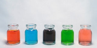 Bottles with colored liquid Stock Photos