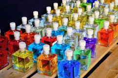 Bottles of colored perfume Royalty Free Stock Photo