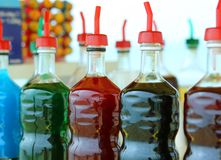 Bottles of colored syrup for preparing ice creams in summer Stock Photo