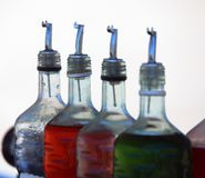 Bottles of colored syrup for preparing ice creams in summer on t Royalty Free Stock Photo