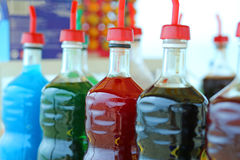 Bottles of colored syrup for preparing ice creams in summer on t Royalty Free Stock Photos