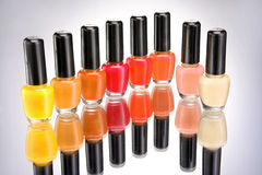 Bottles of colorful nail polish on grey background. Close up Royalty Free Stock Images