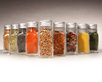Bottles of colorful spices with grey stock photo
