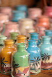 Bottles of coloured sands Stock Image